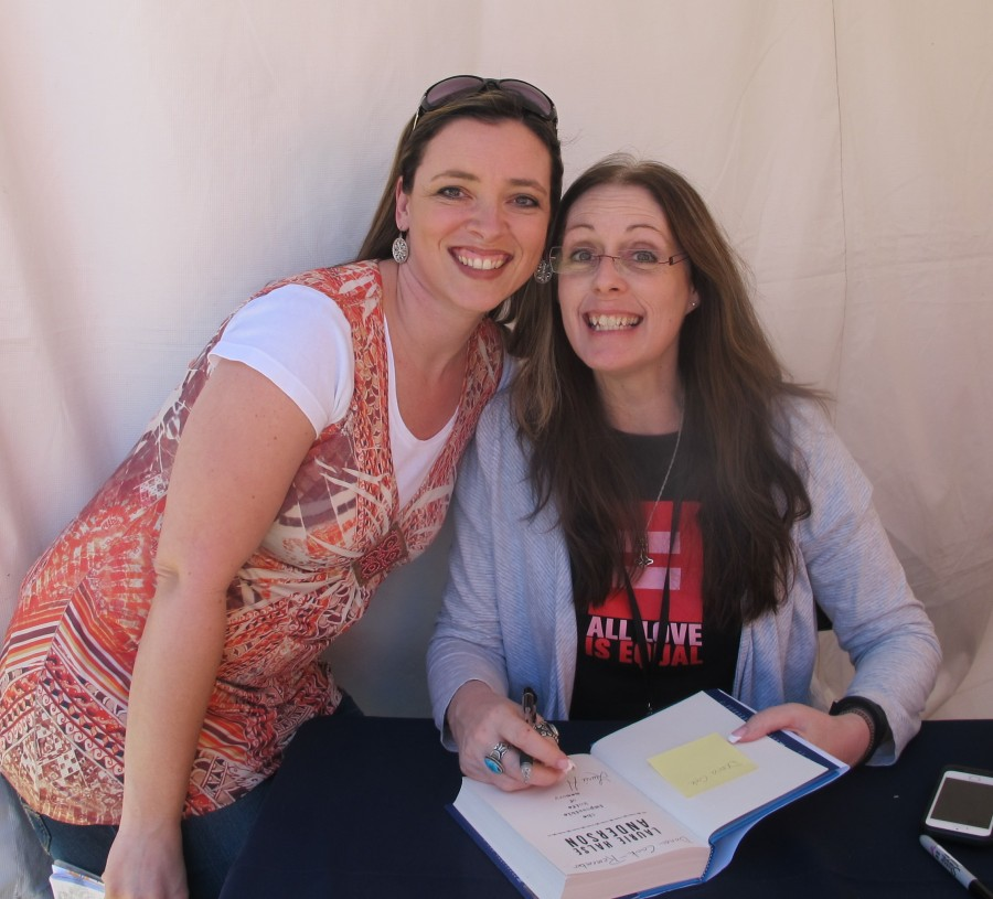 Laurie signing my book. Yay!