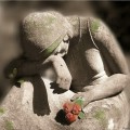 mourning-statue-flower
